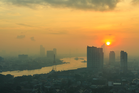 costly: Bangkok,Thailand-Nov 14.LPN costly condominium at dusk with Chao Phraya river with cloud and sun raise on Nov 14,2015 Editorial