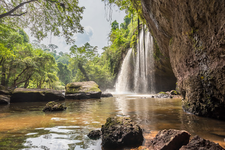 Jungle landscape with flowing turquoise water of  Waterfall cave, Haewsuwat waterfall  in deep tropical rain forest. at Khao Yai National Park , Thailand Zdjęcie Seryjne