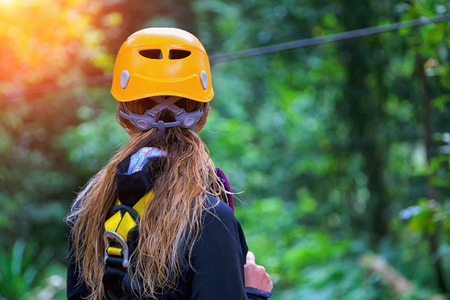 Woman going on a jungle zipline adventure Zdjęcie Seryjne