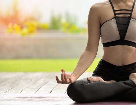young woman do yoga outdoor.