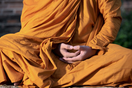 The monk is meditating in the ancient place , Concept of meditation.