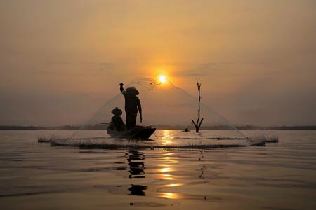 Fisherman net sunset Silhouette boat Zdjęcie Seryjne