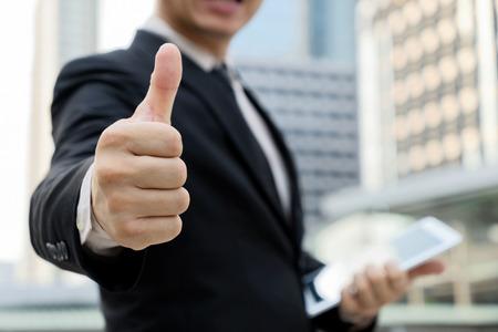 businessman show symbol that great or good. Zdjęcie Seryjne