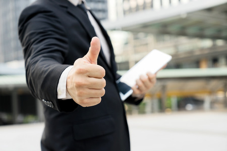 businessman show symbol that great or good