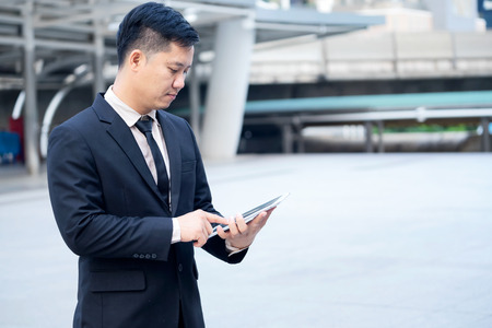 Business people discusing about work using tablet