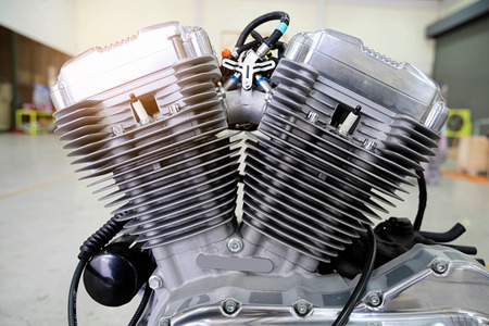 Engine cover cylinder head of motorcycle engine .Motorcycle engine part with sunlight. Zdjęcie Seryjne