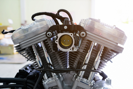 Modern powerful motorcycle engine .Motorcycle engine part with sunlight. Zdjęcie Seryjne