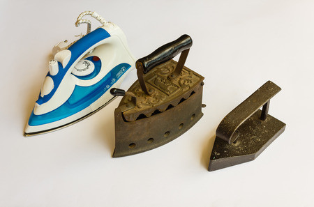 steam iron: evolution overtime in the way of iron with iron types of different ages and styles