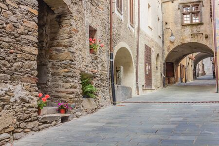 middleages: a quiet medieval village with its typical stone-houses ,the arches and the stone-flooring  uphill