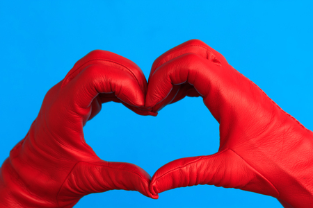 palpitations: two hands with red leather hands forming a heart