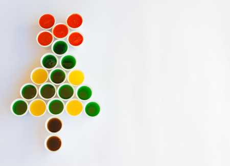 reminiscent: a tree made of glasses filled with colourful liquid reminiscent  a christmas tree