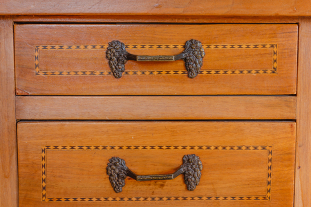 antiquary: particular of an ancient furniture with drawers with inlay Stock Photo