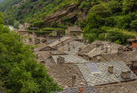 view of stone roofs called the losa roofs of an ancient valdostan village in Italy, are dating back to the 1400-1600, were extracted from the mountain and laid to the roofs Imagens