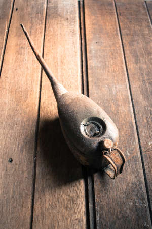 oilcan: Weathered oil can on the wooden