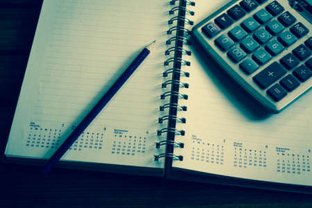 business concept with notebook and calculator photo