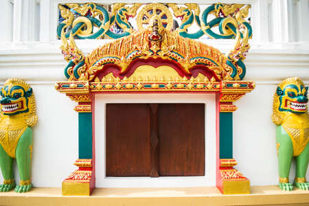 role models: Temple entrance and Singha statue in temple, Thailand Stock Photo