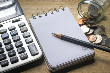 note pad: note pad, pencil, coins and calculator