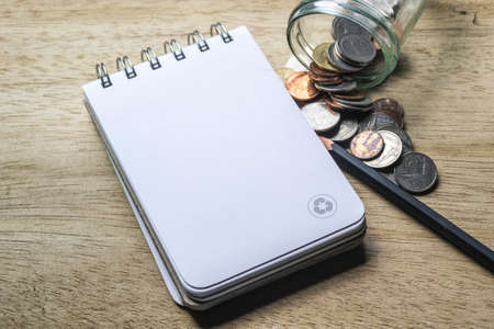 note pad: note pad, pencil and coins