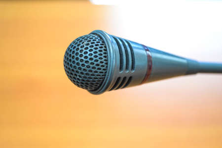 panelist: microphone in a meeting room