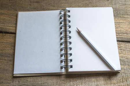 blank page: note book , pencil on old wooden Stock Photo