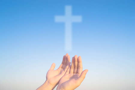 two hands and cross of christ and believers
