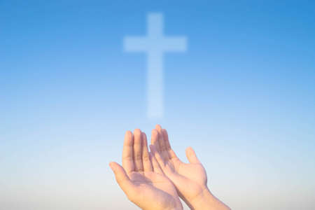 religious life: two hands and cross of christ and believers