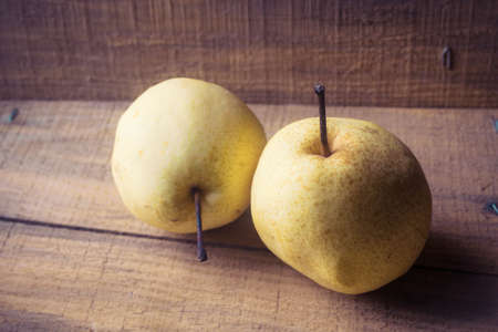 asian pear: Asian pear on wooden Stock Photo
