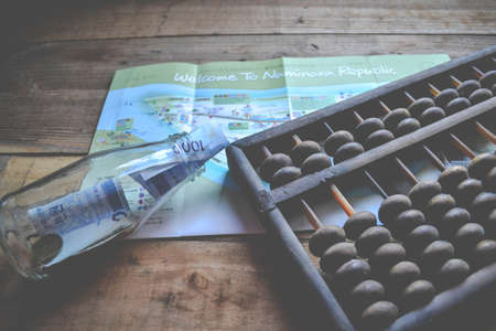 an abacus: Maps, Abacus and money Stock Photo