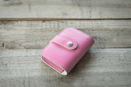 holder: pink leather business card holder Stock Photo