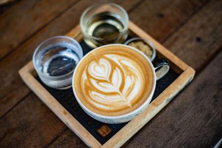 Hot coffee latte closeup photo