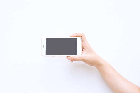 Hands holding a smartphone on a white background Stock Photo - 104666615