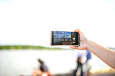 hand using phone taking picture landscape Stock Photo - 106910995