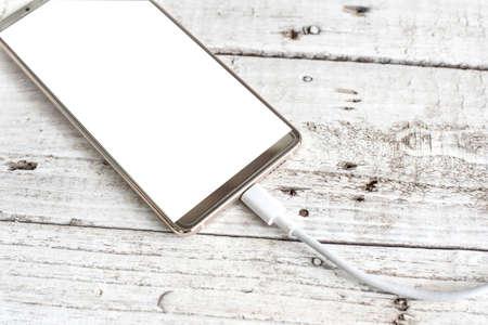 Smartphone blank screen on white wood