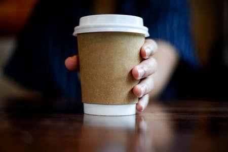 hand holding coffee take away cup