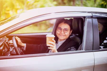 Business woman buy a coffee cup to take away Фото со стока