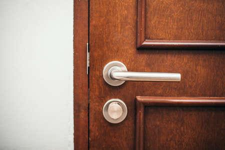 wood door with metallic handle