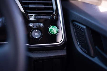 Green eco friendly car button , save energy