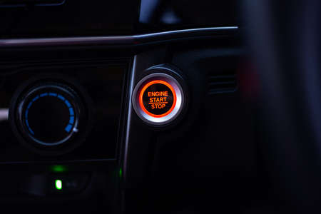 Engine start stop button of a car , Save the world