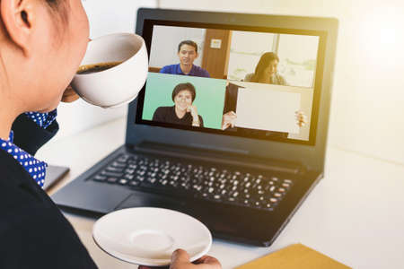 Coworkers Working From Home Having Online Group Videoconference on modern laptop at home Stock Photo