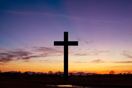 The Cross at the sunset background