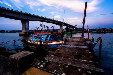 Fishing Boat park near the Bridge Stock Photo