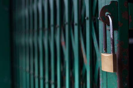 Lock on Green Steel Door Stock Photo