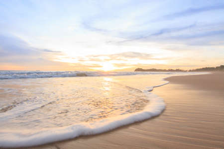 tropical island: Sunset Sea Sand and Wave. Stock Photo