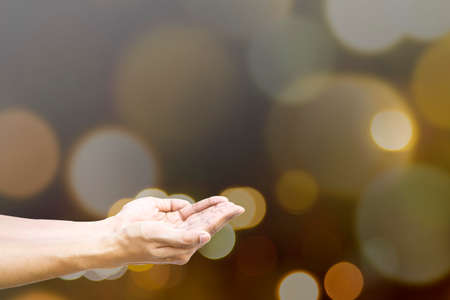close uo: Close uo human hands open palm for giving, help and praying over bokeh background.
