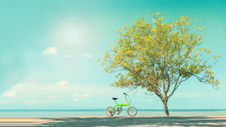 design objects: Vintage bicycle parked in paradise beach blue sky. Stock Photo