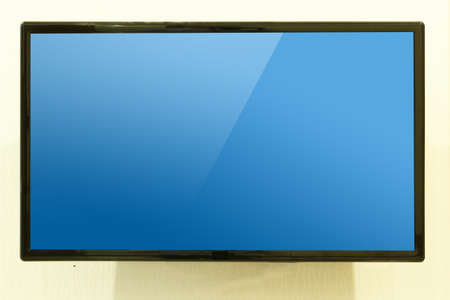 Modern LED Television hang on wall with blue screen