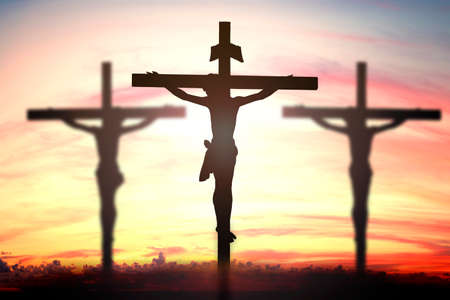 christmas cross: Silhouette of Jesus with Cross over sunset concept for religion, worship, Christmas, Easter, thanksgiving prayer and praise. Stock Photo