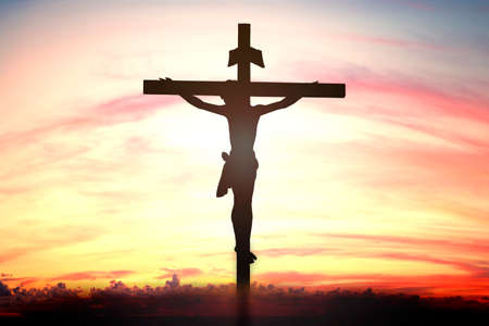 glorify: Silhouette of Jesus with Cross over sunset concept for religion, worship, Christmas, Easter, thanksgiving prayer and praise. Stock Photo