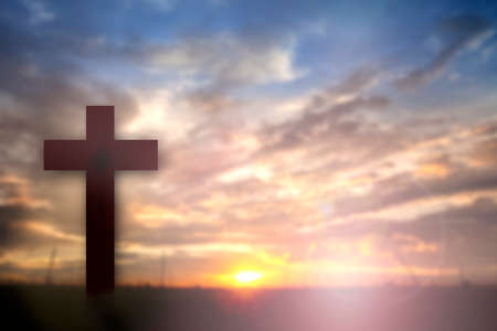 glorify: Silhouette of Jesus with Cross over sunset concept for religion, worship, Christmas, Easter, thanksgiving prayer and praise.? Stock Photo