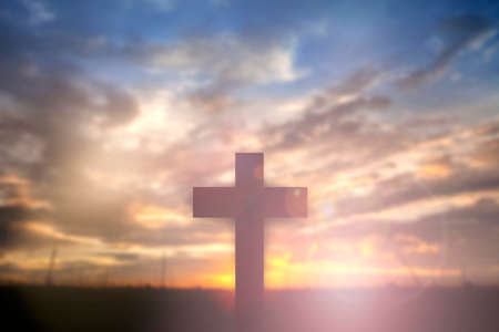 christmas prayer: Silhouette of Jesus with Cross over sunset concept for religion, worship, Christmas, Easter, thanksgiving prayer and praise.? Stock Photo